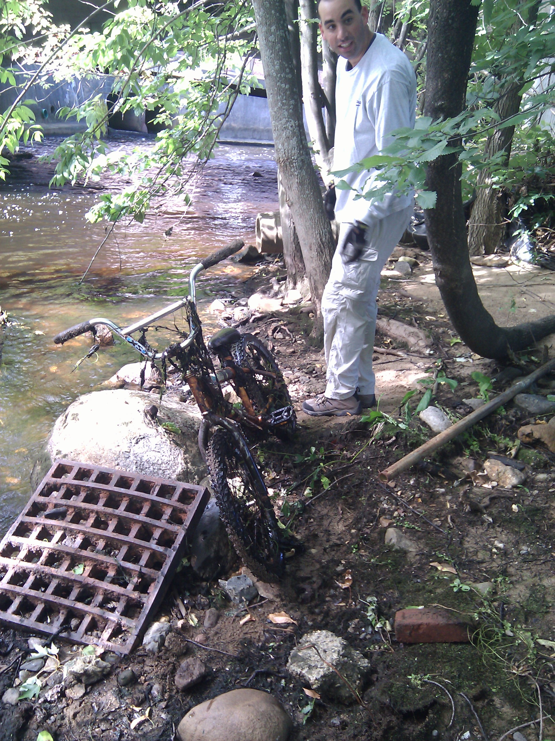 Assabet River cleanup: The bike's finder hauls it out.