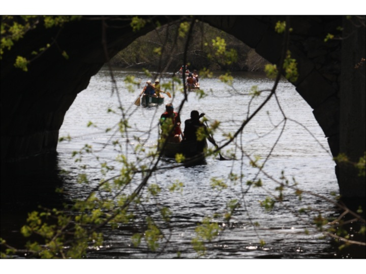 Paddling under a bridge in Newton. Photo: Susan Cline